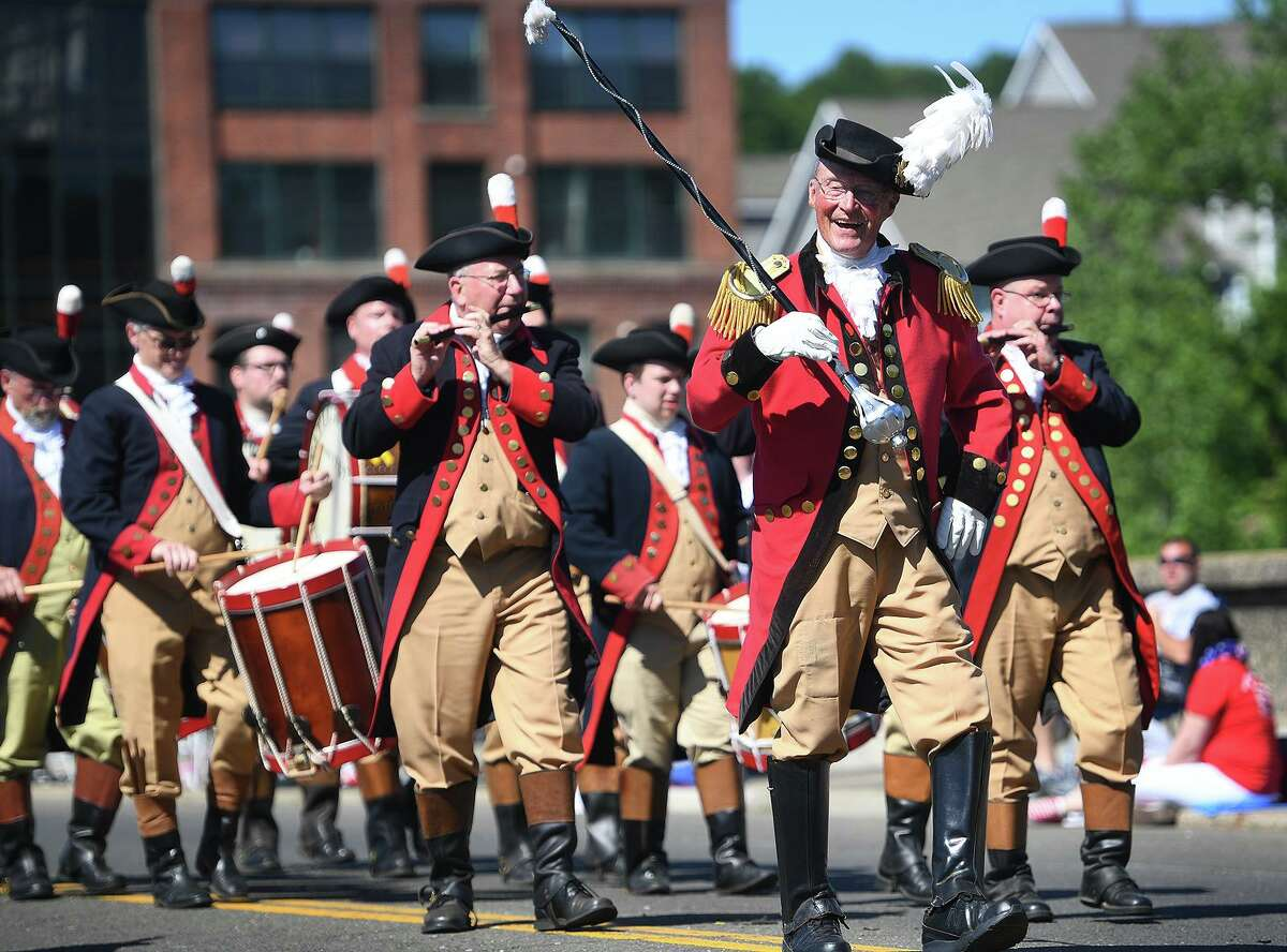 The Mattatuck Drum Band from Waterbury marches in the Derby Shelton Memorial Day Parade on the Derby-Shelton Bridge in Derby, Conn. on Monday, May 27, 2019.