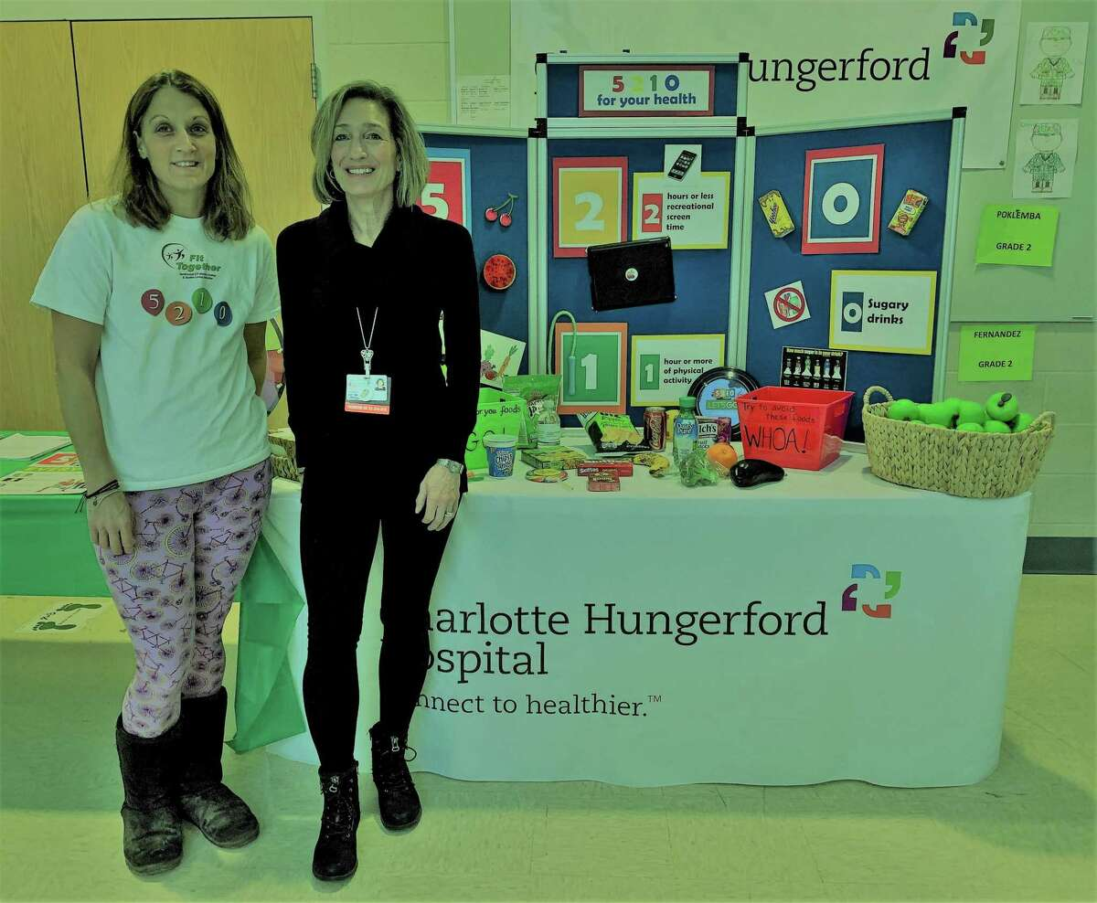 """Fit Together Program Coordinator Jessica Stewart, left, and Charlotte Hungerford Hospital Coordinator of Community Development Joyce Germano, promote healthy living at a kindergarten fair in Torrington. The Torrington School Readiness Council 2021 Kindergarten Readiness Fair, """"Ready... Set ... Kindergarten!"""" was a huge success, reaching more than 200 families."""