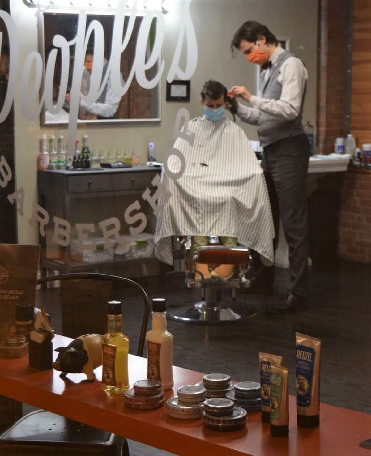 All People's Barbershop owner Brian R. Stevens said he will probably be using just one chair until the pandemic is clearly over.