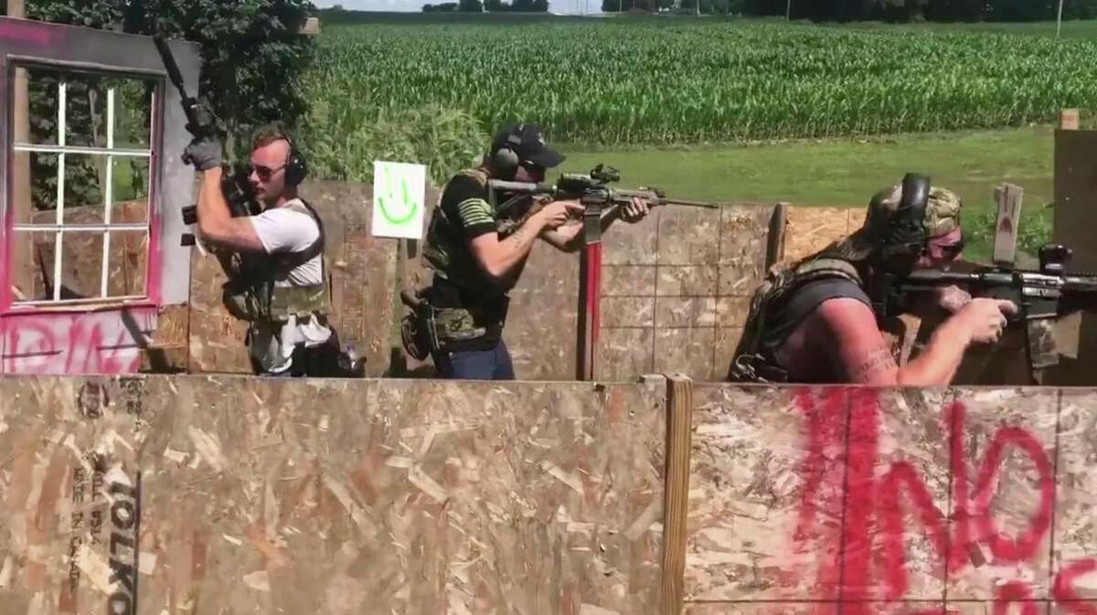 This photo, provided by the U.S. Attorney's Office Western District of Michigan, shows defendant Kaleb Franks (far left) with a rifle equipped with a suppressor, also known as a silencer, used to muffle both the sound and the flash of rifle fire.
