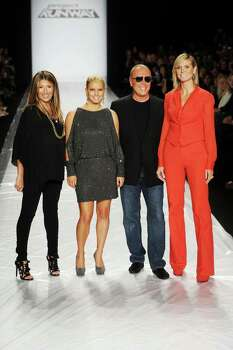 NEW YORK - SEPTEMBER 09:  (L-R) Nina Garcia, Jessica Simpson, Michael Kors and Heidi Klum pose on the runway at the Project Runway Spring 2011 fashion show during the Mercedes-Benz Fashion Week Spring 2011 Official Coverage at Lincoln Center on September 9, 2010 in New York City.  (Photo by Frazer Harrison/Getty Images for Mercedes-Benz) *** Local Caption *** Nina Garcia;Jessica Simpson;Michael Kors;Heidi Klum Photo: Frazer Harrison, Getty Images For Mercedes-Benz / 2010 Getty Images