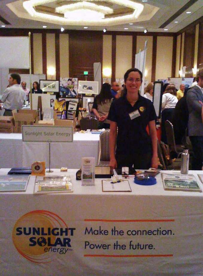 Carolyn Humphreys of Sunlight Solar Energy is one of more than hundred exhibitors who will be on hand at Live Green CT! Photo: Contributed Photo / Connecticut Post Contributed