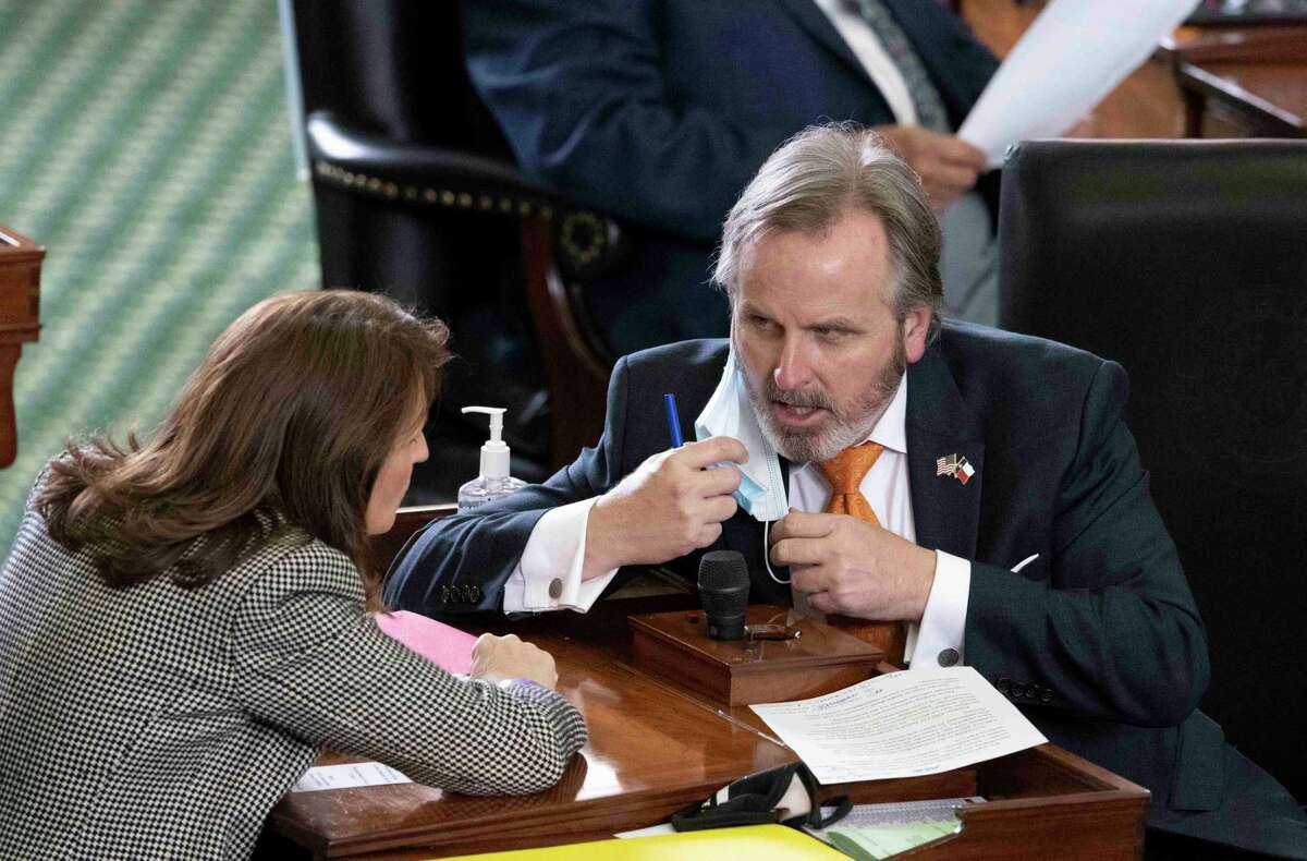 Bryan Hughes of Mineola, with fellow GOP state Sen. Angela Paxton of McKinney, is the author of a bill on voting restrictions passed by the Texas Senate.