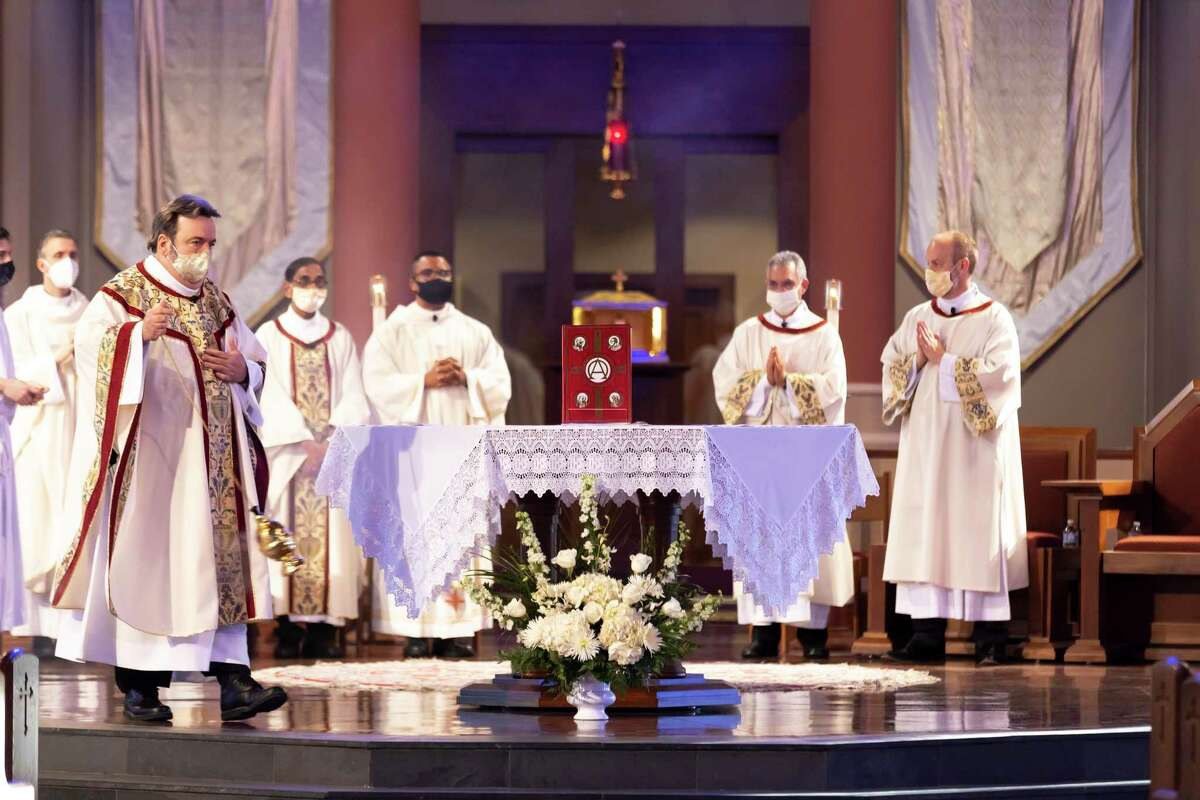 Catholic priests and serviceman begin services during a Maundy Thursday celebration at St Anthony of Padua Catholic Church, Thursday, April 1, 2021, in The Woodlands. Parishioners were asked to make reservations to attend this year's celebration due to the ongoing COVID-19 pandemic.