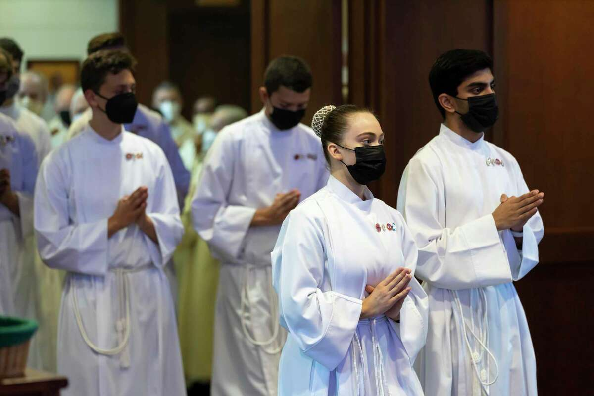 Alter services begin services during a Maundy Thursday celebration at St Anthony of Padua Catholic Church, Thursday, April 1, 2021, in The Woodlands. Parishioners were asked to make reservations to attend this year's celebration due to the ongoing COVID-19 pandemic.