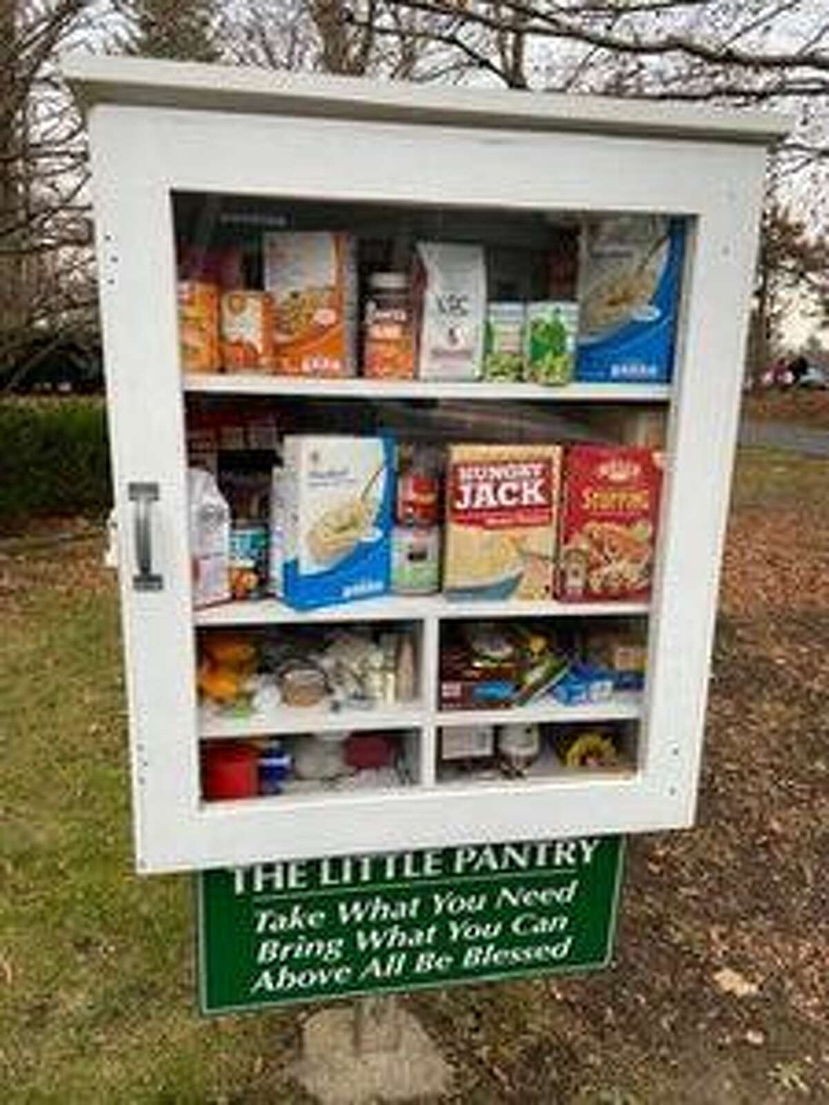 """The Little Pantry provides canned and packaged food items to families in need on a """"take what you need, bring what you can"""" basis."""