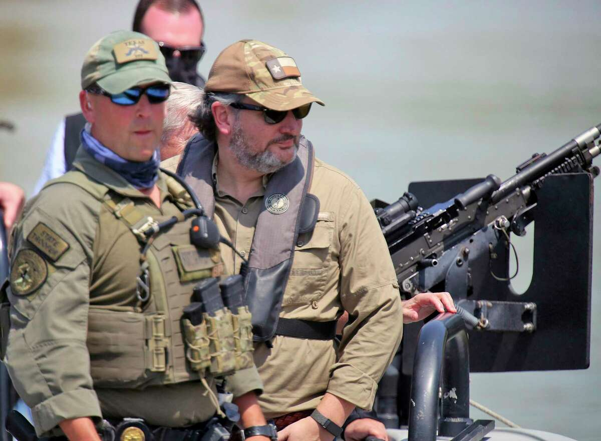 U.S. Sen. Ted Cruz, R-Texas, right, takes a boat tour on the Rio Grande with state troopers before a March 26 press conference in Mission.