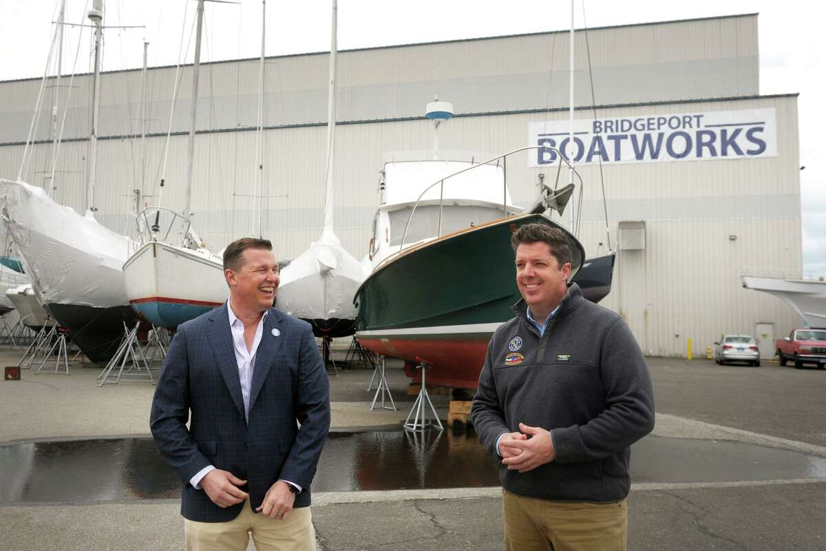 Robert Christoph, Jr., left, president of RCI Group and Harry Boardsen, owner of Bridgeport Boatworks, pause for a laugh in early April during an interview at Bridgeport Boatworks property in Bridgeport, Conn.