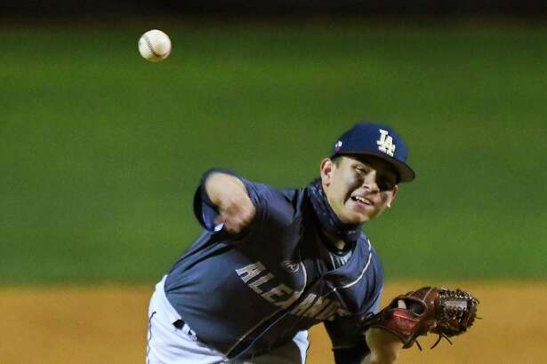 Alexander High School Robert Villarreal pitches during a game against United High School, Thursday, Apr. 1, 2021, at the UISD Student Activity Complex.