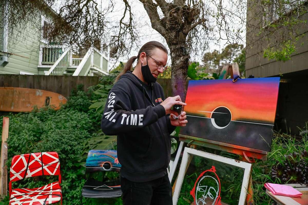 Frank Jaworski paints in his yard in San Francisco.