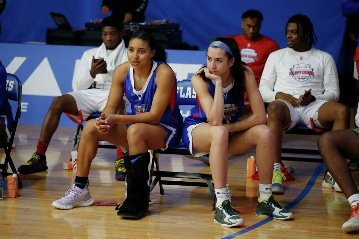 From left to right Azzi Fudd and Caroline Ducharme, who both plan to attend UConn watch during the 3-point shooting contest on March 30, 2021, during the American Family Insurance High School Slam Dunk & 3 Point Championships at Franklin Central High School in Indianapolis.