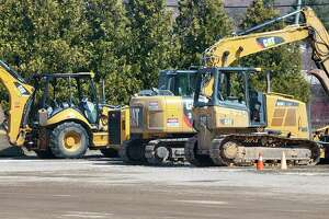 Construction equipment and materials for water main infrastructure stated near the bottom of Gateway Hill where construction on M-22 will begin at the intersection between Lake Street (M-22) and Forest Avenue (M-115). (Colin Merry/Record Patriot)