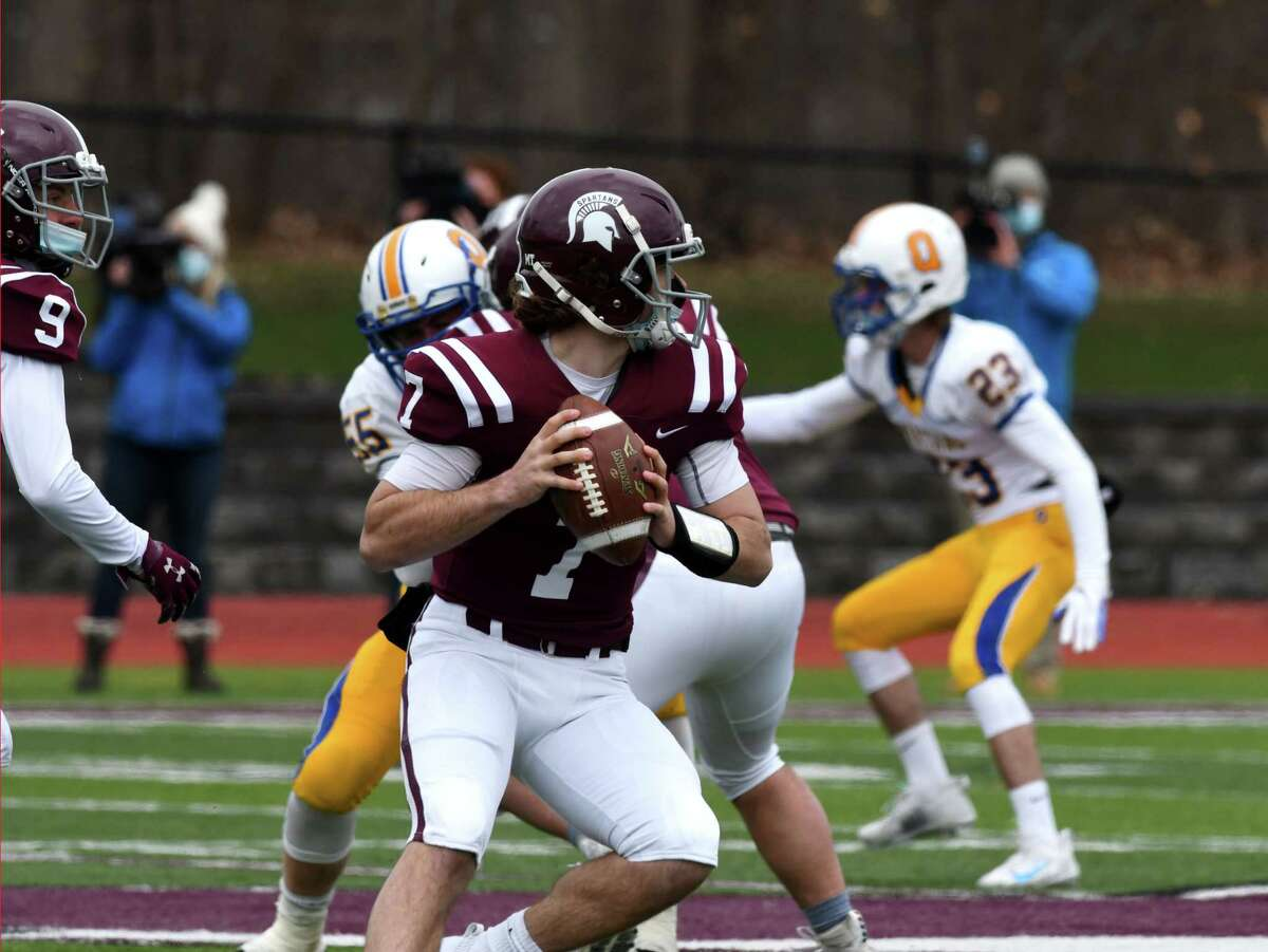 Burnt Hills-Ballston Lake quarterback Caeden Lapietro looks downfield for a pass is against Queensbury during a varsity football game on Friday, April 2, 2021, at Burnt Hills-Ballston Lake High School in, N.Y. (Will Waldron/Times Union)