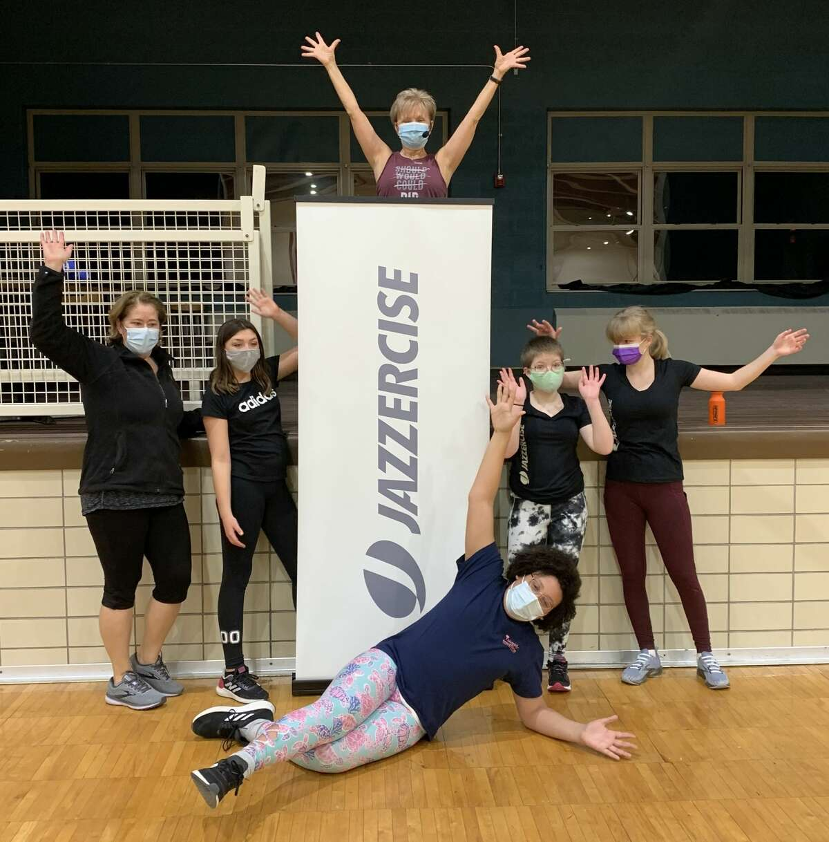 Jazzercise instructor Linda DeVries (back row) poses for a photo with students at the Armory Youth Project in Manistee. DeVries has been teaching Jazzercise for 35 years.