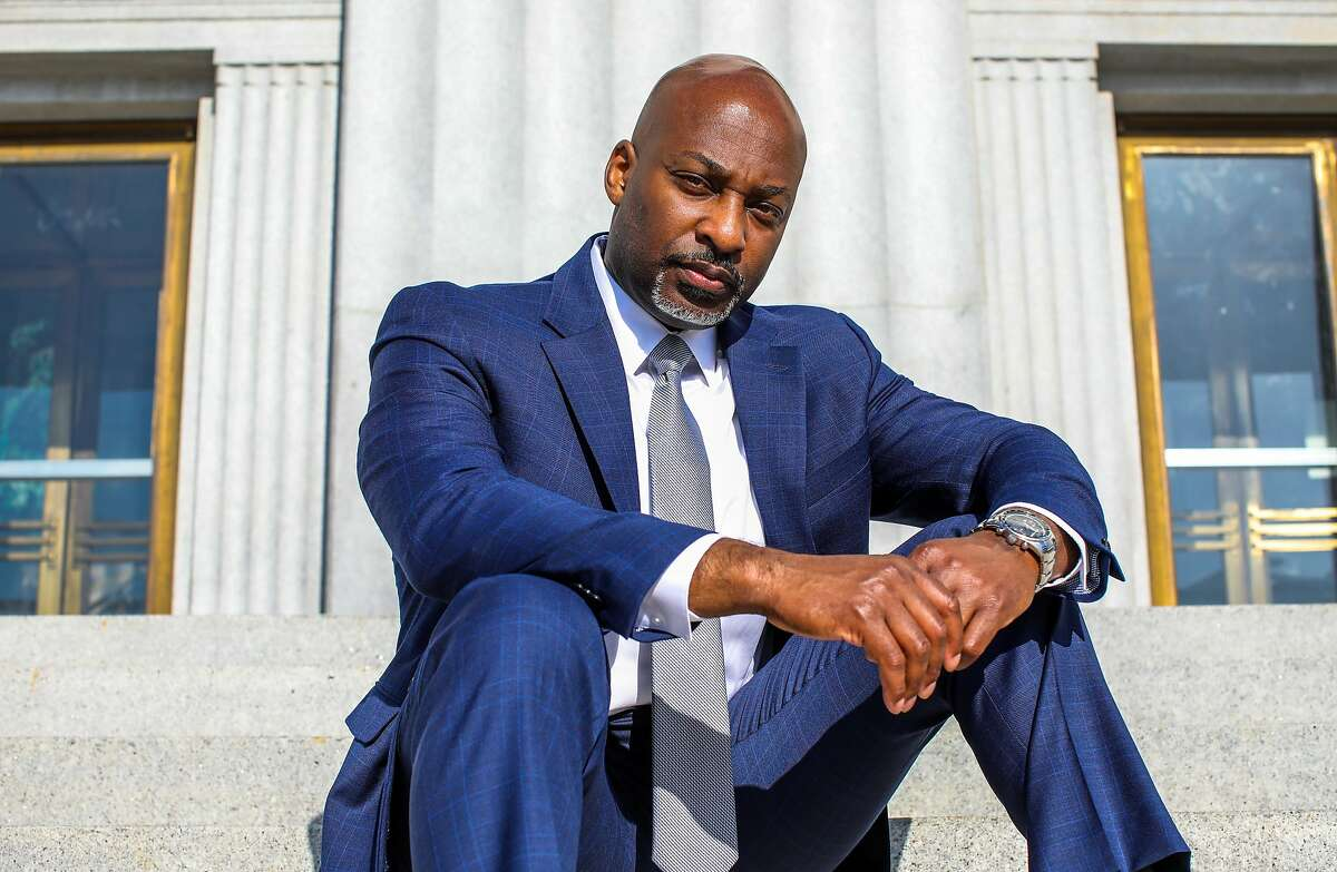 Alameda County Public Defender Brendon Woods, sitting on the steps of the county courthouse, is leading a local effort to make jury selection more representative.