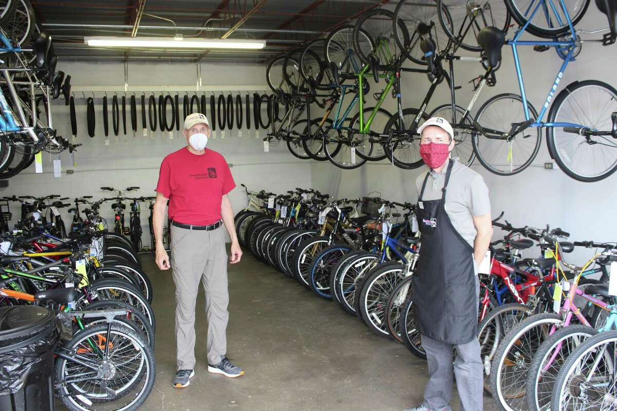 Volunteers Bill Chapman (left) and Bruce Clark (right) help make Freewheels Houston the organized non-profit that it is today.