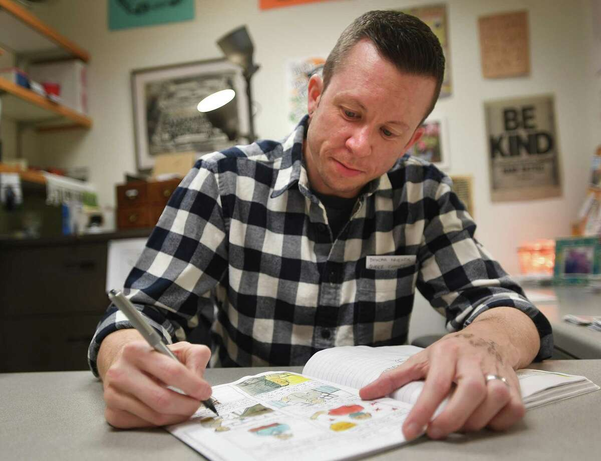 KC Councilor, an associate professor of communications, helped in discovering his identity as a transgender man through cartoons and comics, at Southern Connecticut State University in New Haven Thursday, April 1, 2021.