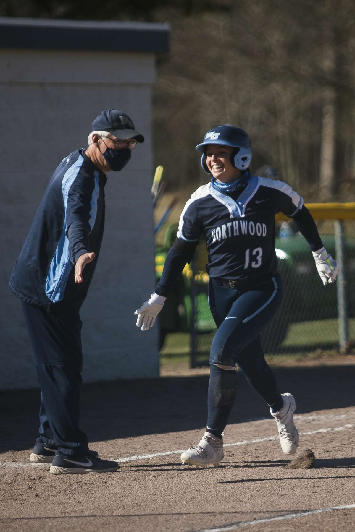 Northwood's Maddie Coulter jogs towards home base after hitting a home run during the Timberwolves' doubleheader against Wayne State Friday, April 2, 2021 at Northwood University. (Katy Kildee/kkildee@mdn.net)