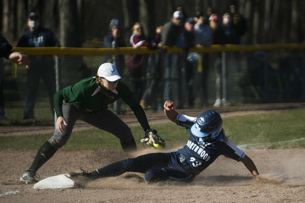 Northwood's Julia Gross slides into third base during the Timberwolves' doubleheader against Wayne State Friday, April 2, 2021 at Northwood University. (Katy Kildee/kkildee@mdn.net)