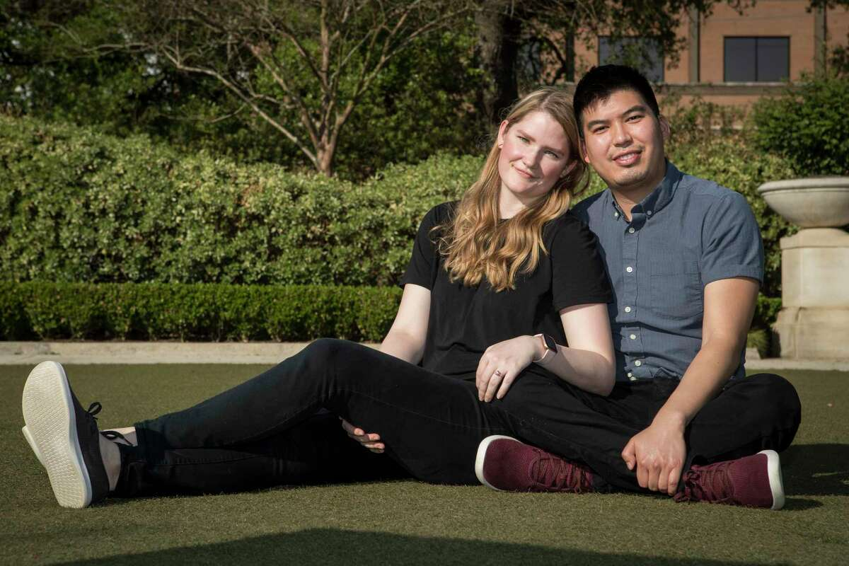 Kevin Velasquez and Kathryn Dianiska pose for a portrait at the site of their wedding, Hermann Park's McGovern Centennial Gardens, Thursday, April 1, 2021 in Houston. The couple were engaged in December and planned an 80-person wedding when COVID-19 restrictions shut things down. Now they are planning a wedding in the Celebration Garden with 11 people attending, with Velasquez's best friend will officiating and music being provided by a Bluetooth speaker.