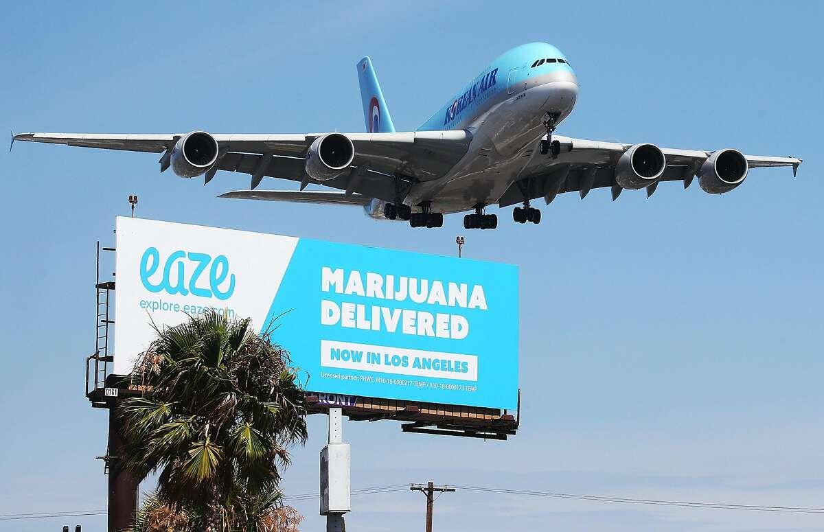 Corrupting kids? A billboard near Los Angeles International Airport advertises the marijuana delivery service Eaze in 2018.