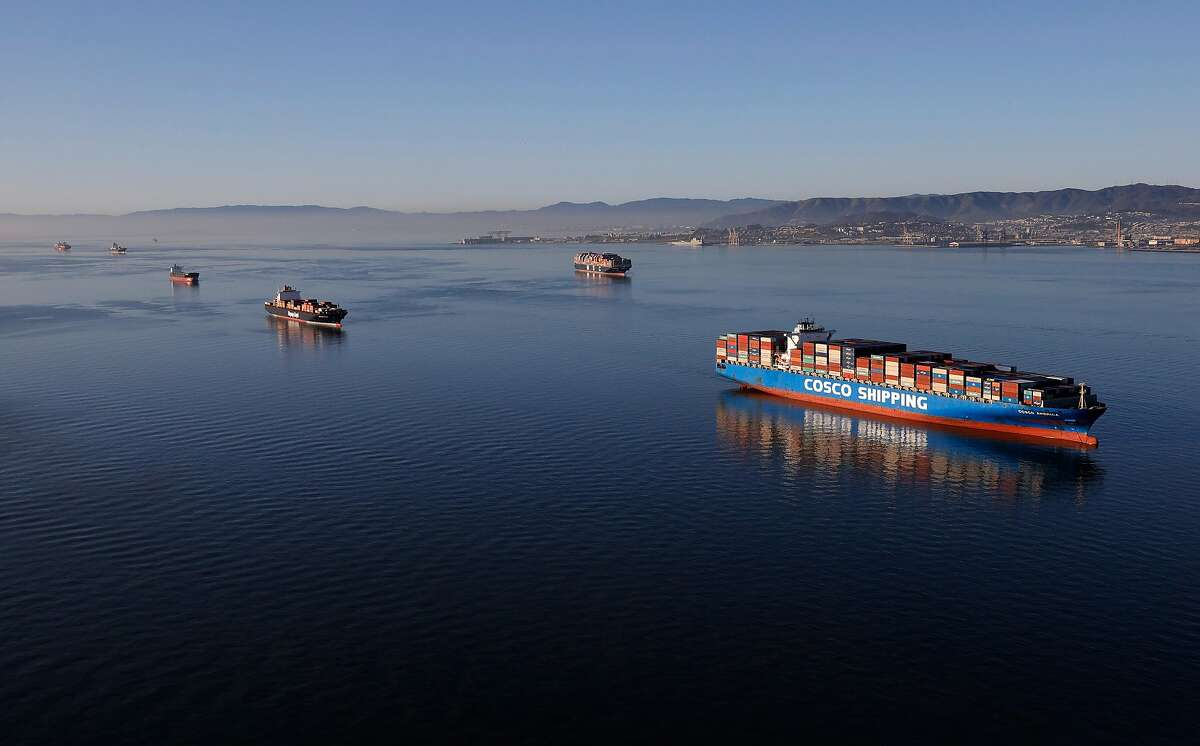There were 15 huge cargo ships anchored south of the Bay Bridge at midweek. Nine more big ships were waiting in the Pacific, steaming up and down offshore between Santa Cruz and Half Moon Bay.