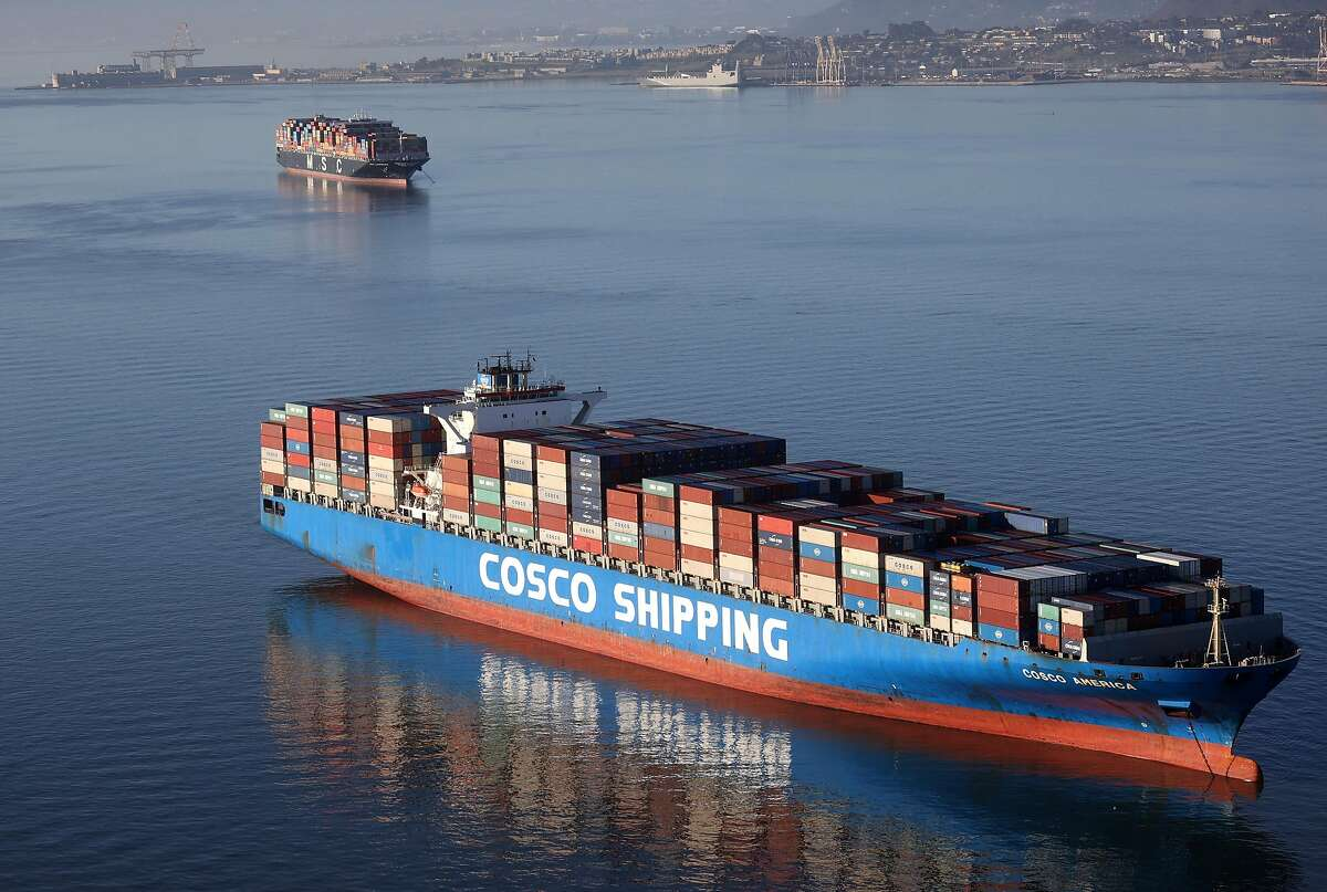Container ships sitting idle in the bay just outside the Port of Oakland face long delays in part because of a pandemic-related shortage of dock workers.