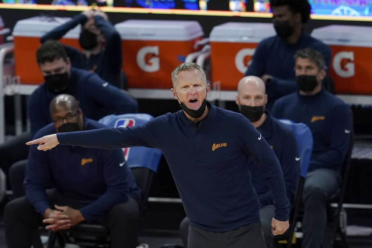 Golden State Warriors coach Steve Kerr gestures during the second half of the team's NBA basketball game against the Philadelphia 76ers in San Francisco, Tuesday, March 23, 2021. (AP Photo/Jeff Chiu)