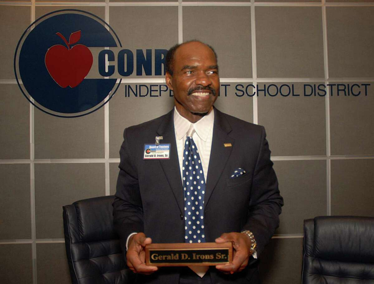 Gerald Irons holds his name plaque as he stands by his seat at the Conroe ISD Board Room. The Woodlands resident Gerald Irons is retiring, at the end of his term, from the Conroe ISD Board of Trustees. Irons has served CISD since may 22, 1990. Conroe ISD has grown by 29,000 students, current enrollment is 51,150, since Irons was elected. Photo by David Hopper