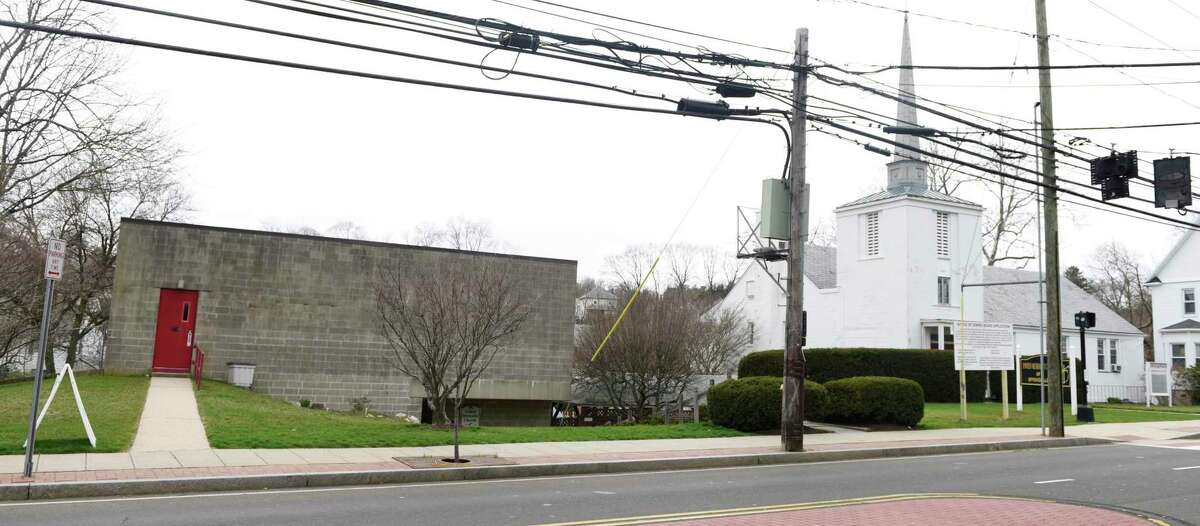 A proposal has been submitted for deeply affordable housing at 1114 Hope St. in the Springdale section of Stamford, Conn., photographed here on Wednesday, March 31, 2021. Area residents have argued that the development would be too dense, contain too many units, and exacerbate parking concerns in the neighborhood. The propsal would demolish the concrete structure at 1114 Hope St. to make way for an apartment complex while preserving the church next door and converting it into apartments.