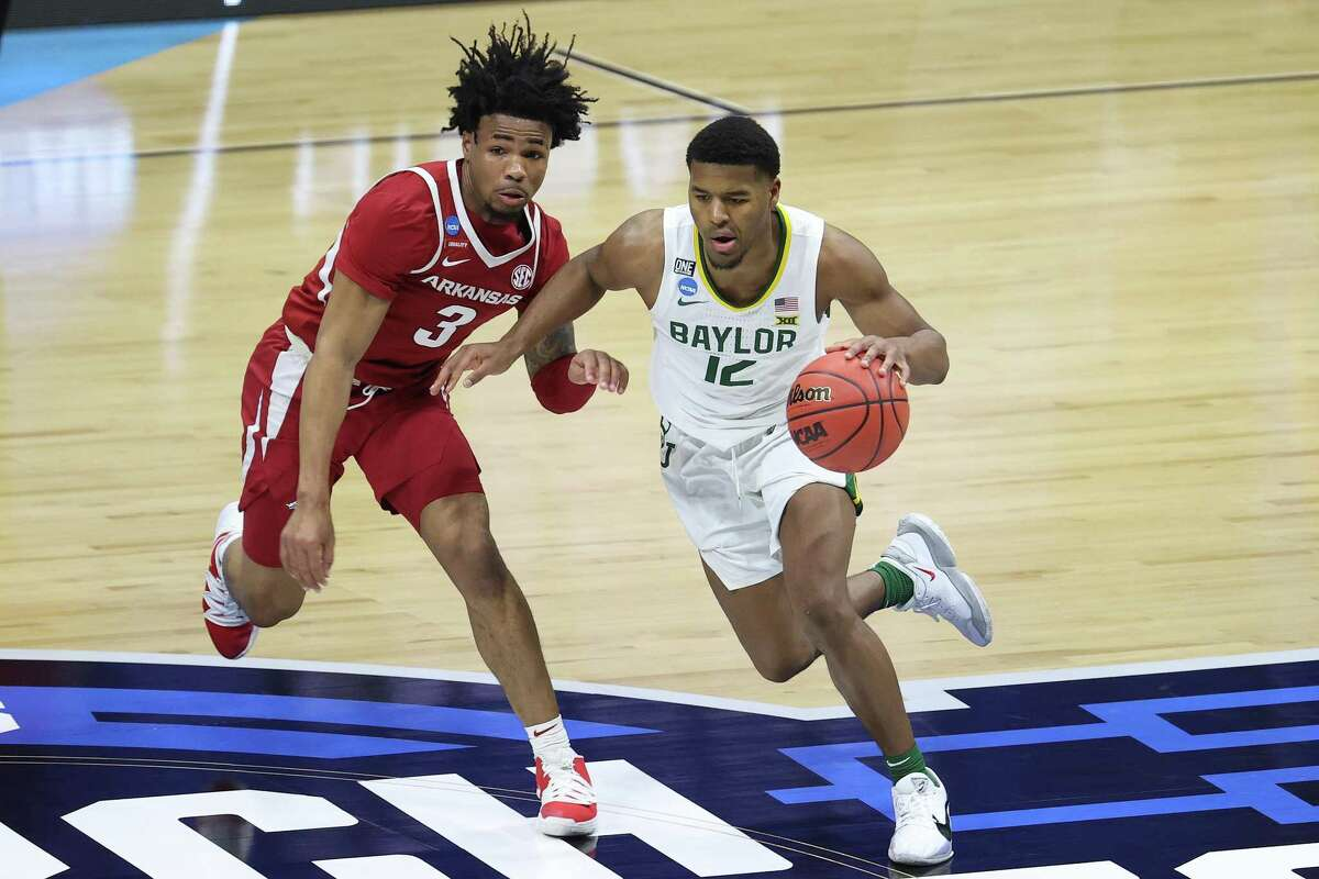 Jared Butler, driving against Arkansas in the Elite Eight, came back to Baylor to have a shot at NCAA title after 2020 touranment was canceled.
