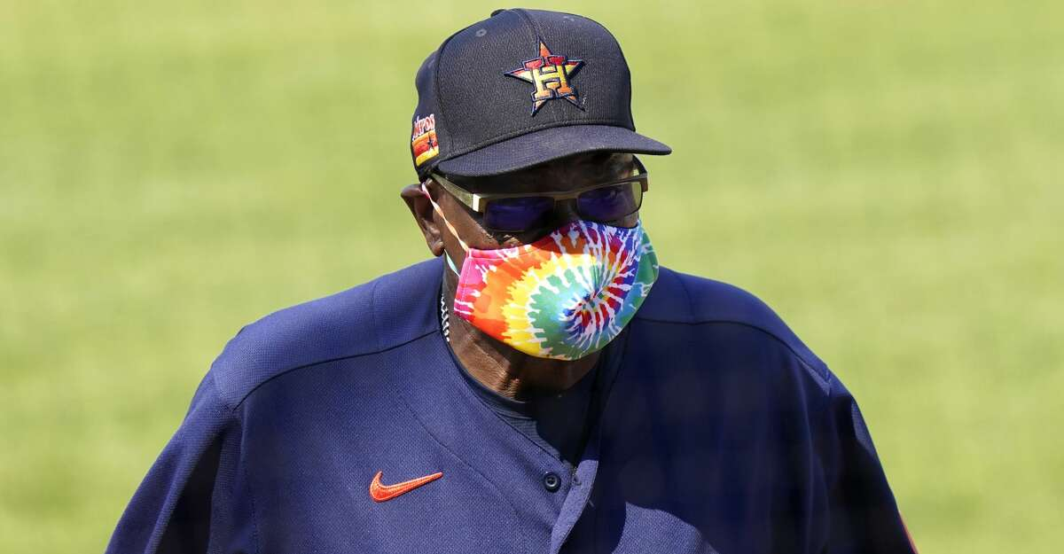 Houston Astros manager Dusty Baker Jr. walks to the dugout after a pitching change during the sixth inning of a spring training baseball game against the New York Mets, Tuesday, March 16, 2021, in Port St. Lucie, Fla. (AP Photo/Lynne Sladky)