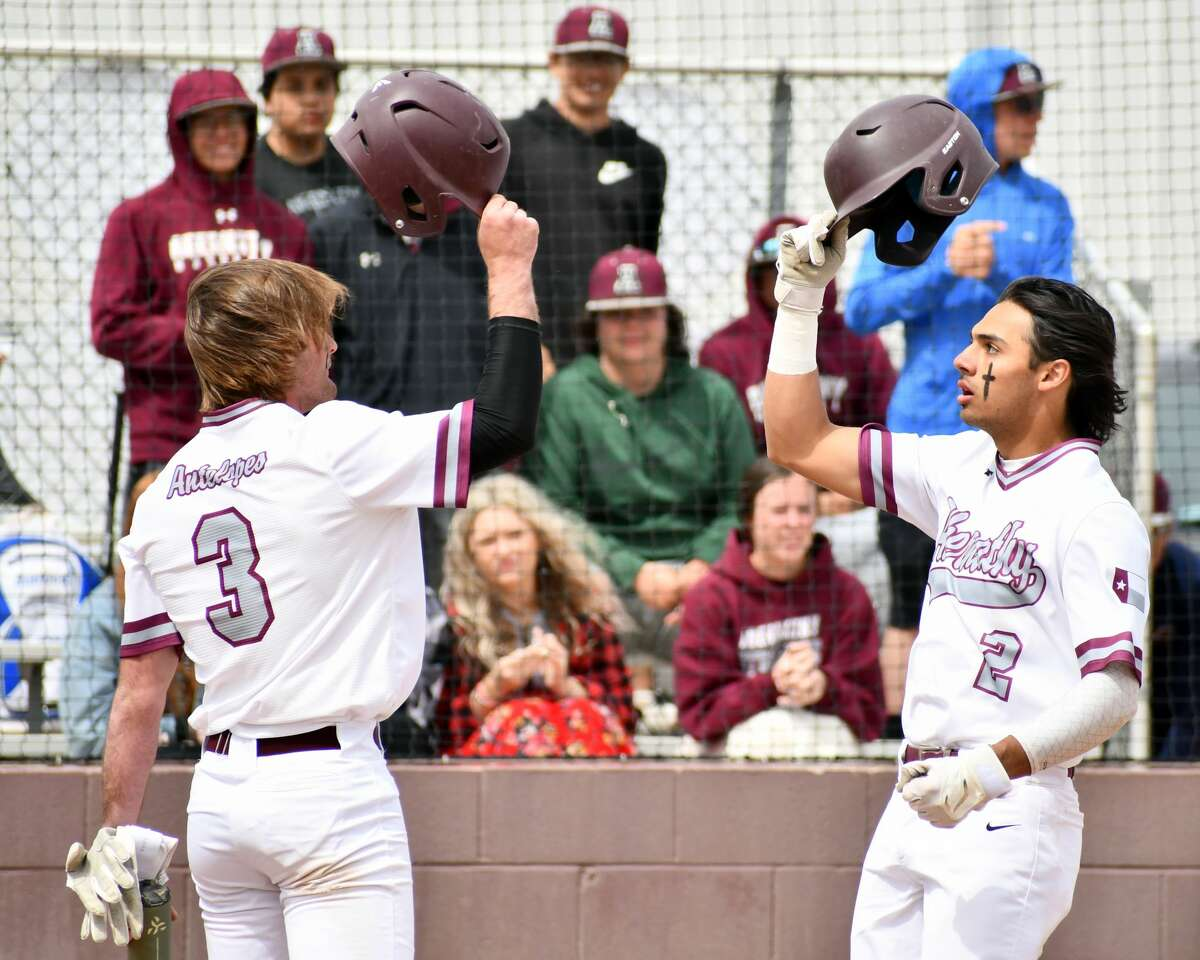 Kaeleb Carrillo (right) and Jess Hoel celebrate Carrillo's two-run home run in the first inning.