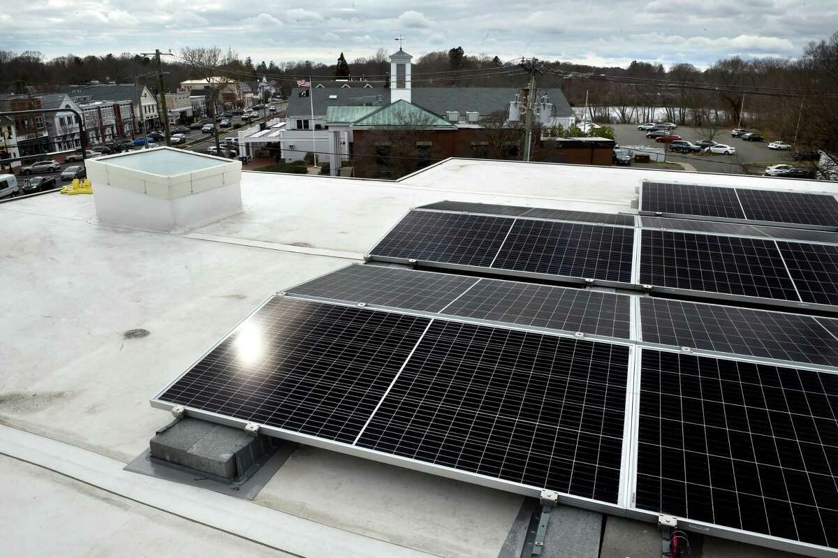 New solar photovoltaic panels are spread across the roof of the expanded section of the E.C. Scranton Memorial Library in Madison on April 1, 2021.