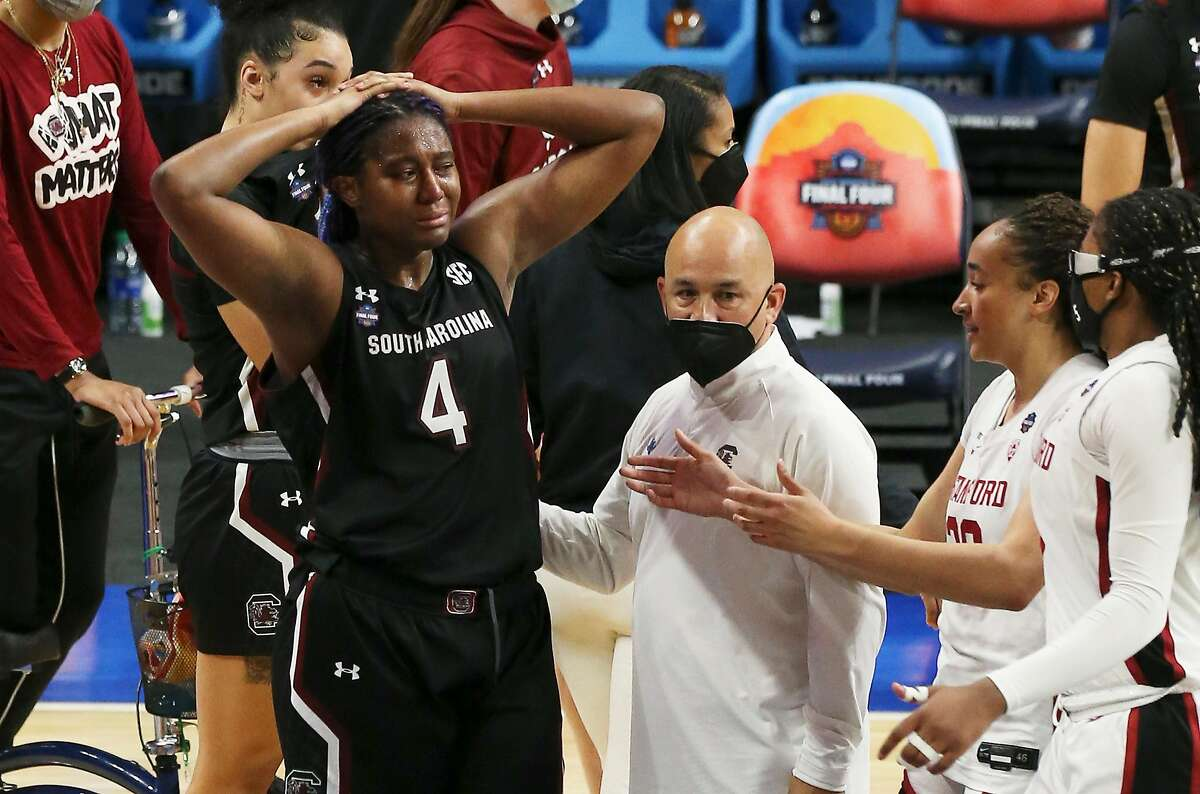 South Carolina's Aliyah Boston (04) reacts with despair after her team loses to Stanford during their 2021 NCAA Women's Final Four national semifinal basketball game at the Alamodome on Friday, Apr. 2, 2021. Stanford defeated South Carolina, 66-65 to advance to the championship game.
