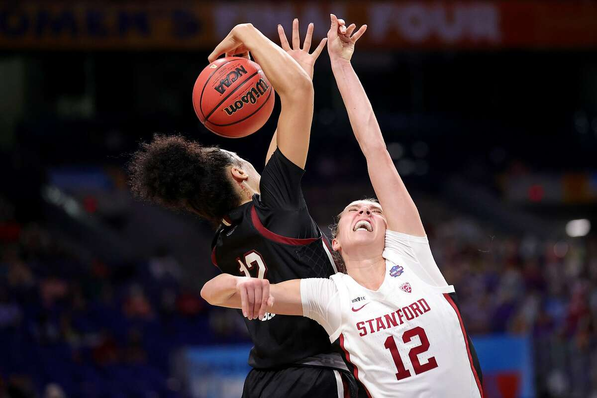 SAN ANTONIO, TEXAS - APRIL 02: Brea Beal #12 of the South Carolina Gamecocks steals the ball from Lexie Hull #12 of the Stanford Cardinal during the second quarter in the Final Four semifinal game of the 2021 NCAA Women's Basketball Tournament at the Alamodome on April 02, 2021 in San Antonio, Texas. (Photo by Carmen Mandato/Getty Images)