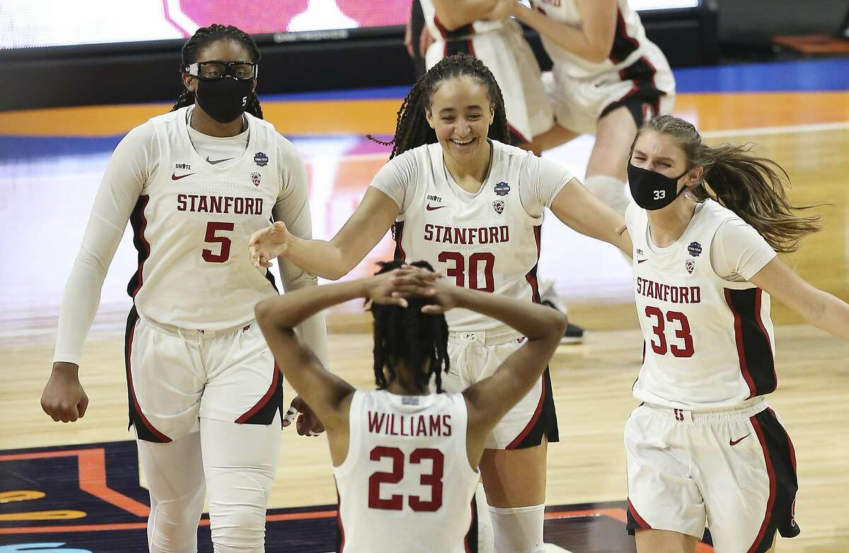 Stanford's Francesca Belibi (05), Haley Jones (30), Hannah Jump (33) and Kiana Williams (23) celebrate after defeating South Carolina during their 2021 NCAA Women's Final Four national semifinal basketball game at the Alamodome on Friday, Apr. 2, 2021. Stanford defeated South Carolina, 66-65 to advance to the championship game.