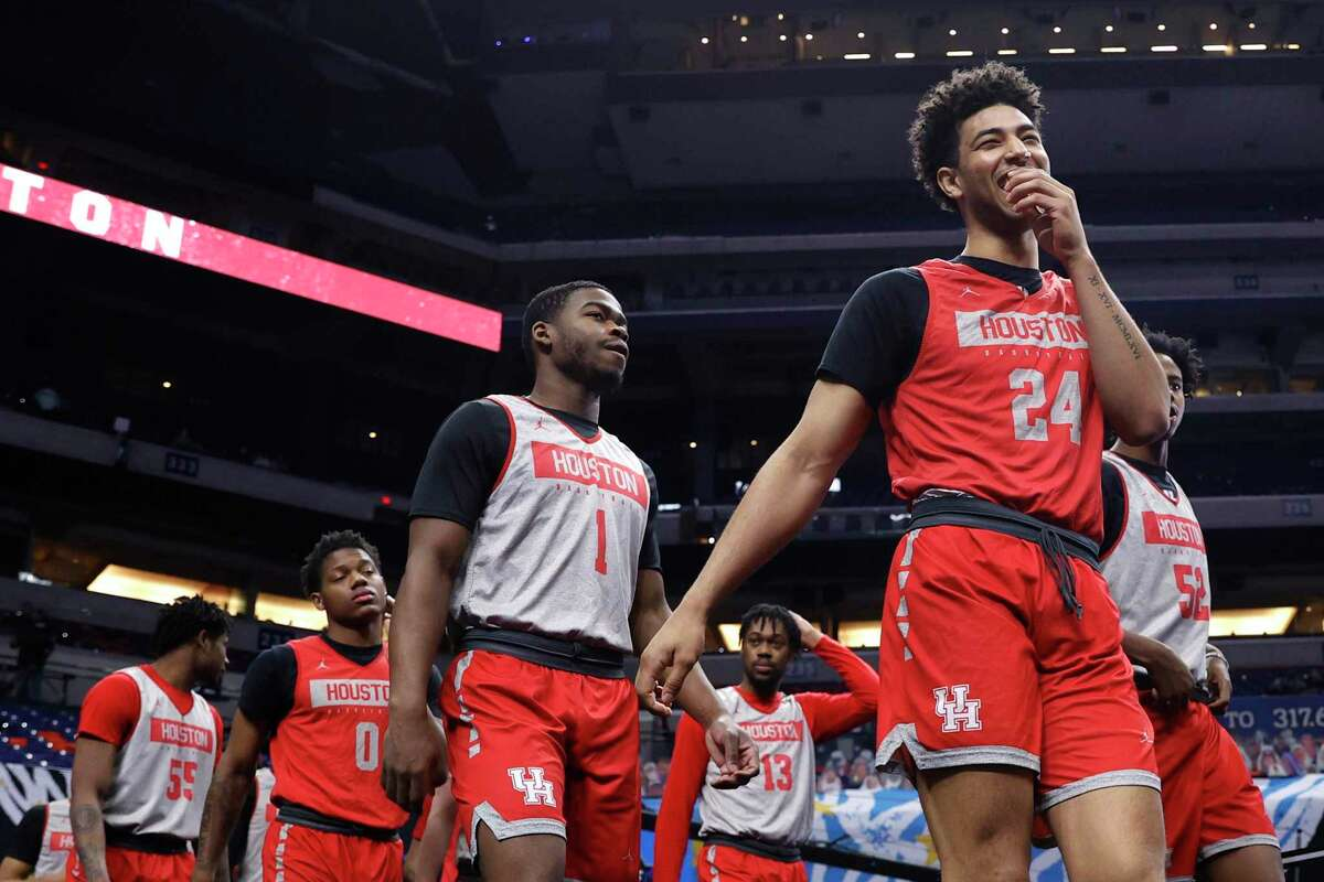 Quentin Grimes (24) and Jamal Shead (1) of the Houston Cougars take the court with their teammates for practice ahead of the Final Four Semifinal at Lucas Oil Stadium in Indianapolis.