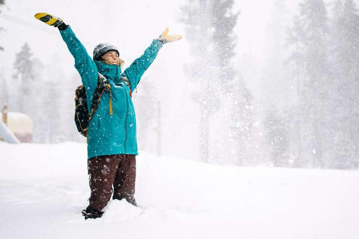 Sarah Sherman does a snow dance while a storm hits Lake Tahoe in November 2019.