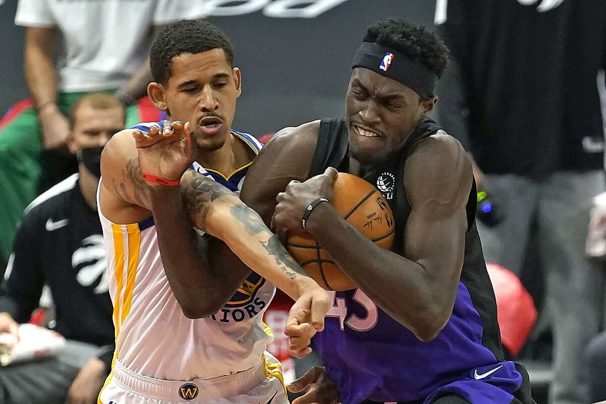 Toronto Raptors forward Pascal Siakam (43) and Golden State Warriors forward Juan Toscano-Anderson (95) get tangled up during the first half of an NBA basketball game Friday, April 2, 2021, in Tampa, Fla. (AP Photo/Chris O'Meara)