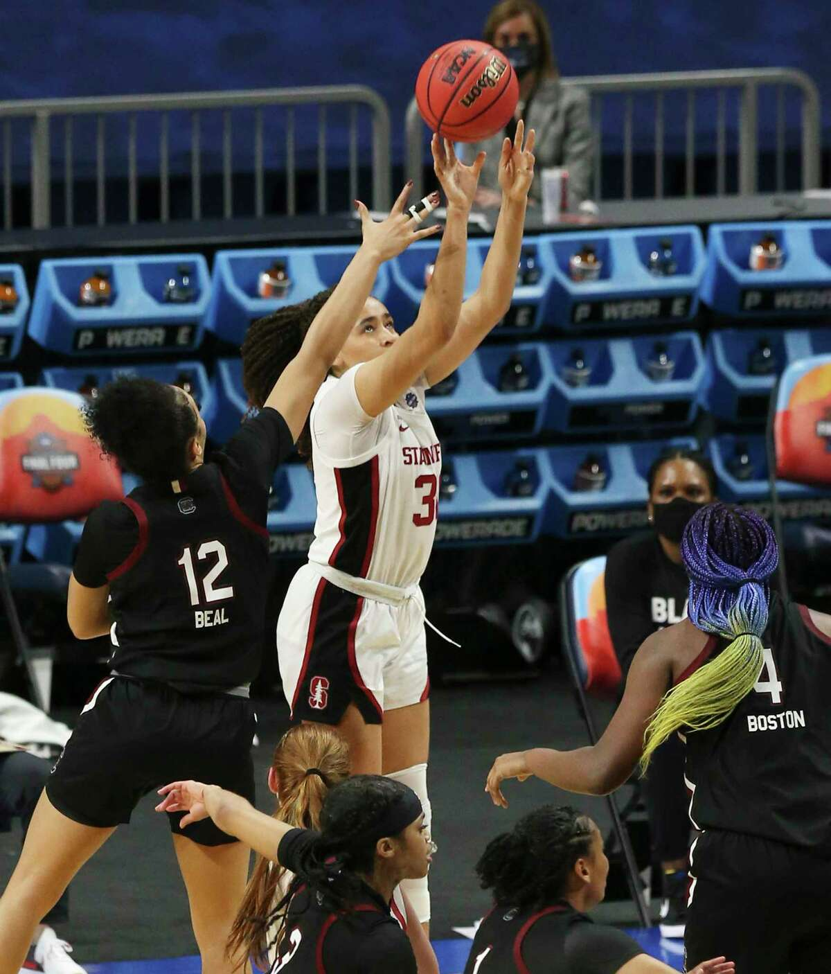 Stanford's Haley Jones (30) hits the go ahead score against South Carolina's Brea Beal (12) during their 2021 NCAA Women's Final Four national semifinal basketball game at the Alamodome on Friday, Apr. 2, 2021. Stanford defeated South Carolina, 66-65 to advance to the championship game.