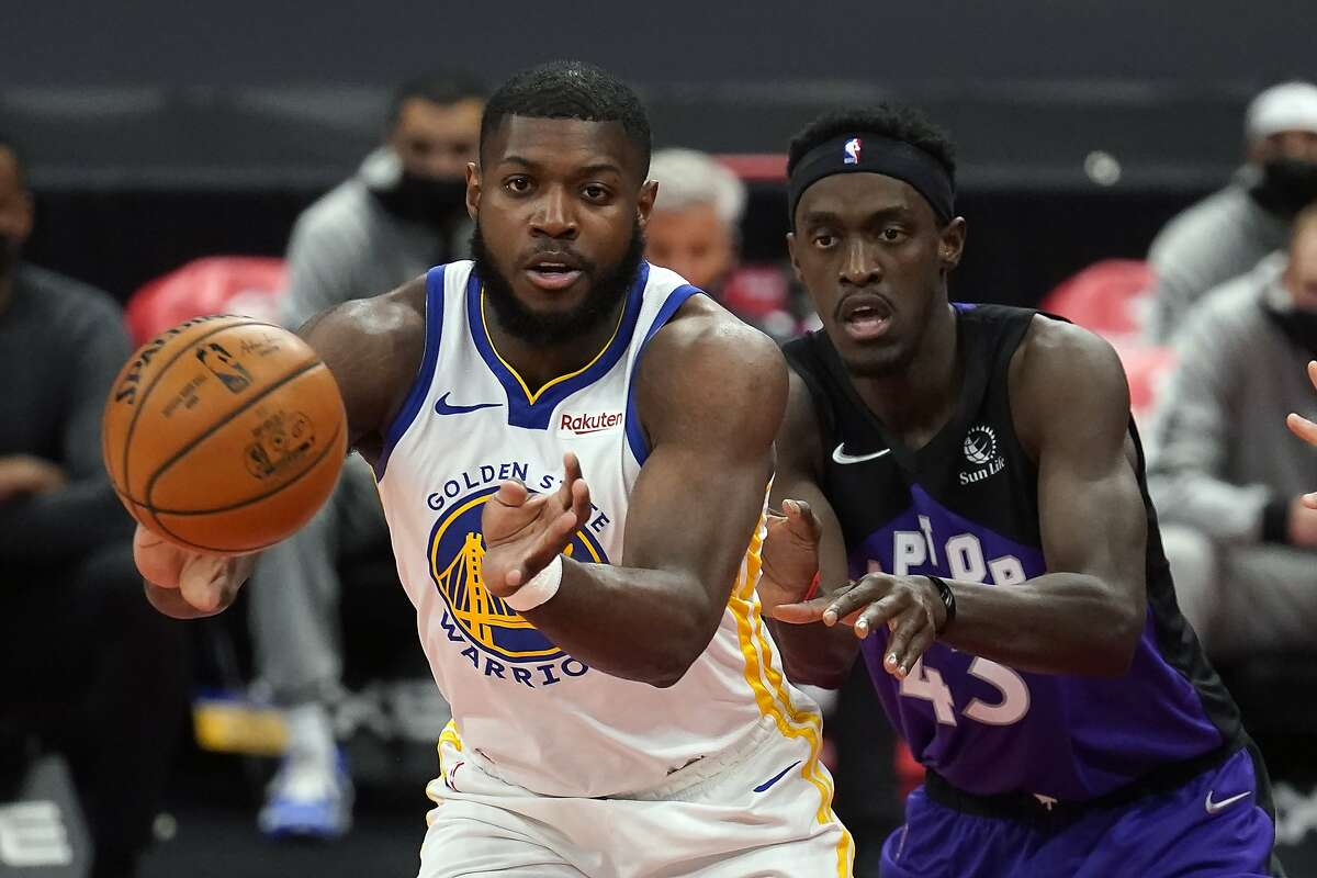 Golden State Warriors forward Eric Paschall (7) grabs a pass in front of Toronto Raptors forward Pascal Siakam (43) during the first half of an NBA basketball game Friday, April 2, 2021, in Tampa, Fla. (AP Photo/Chris O'Meara)