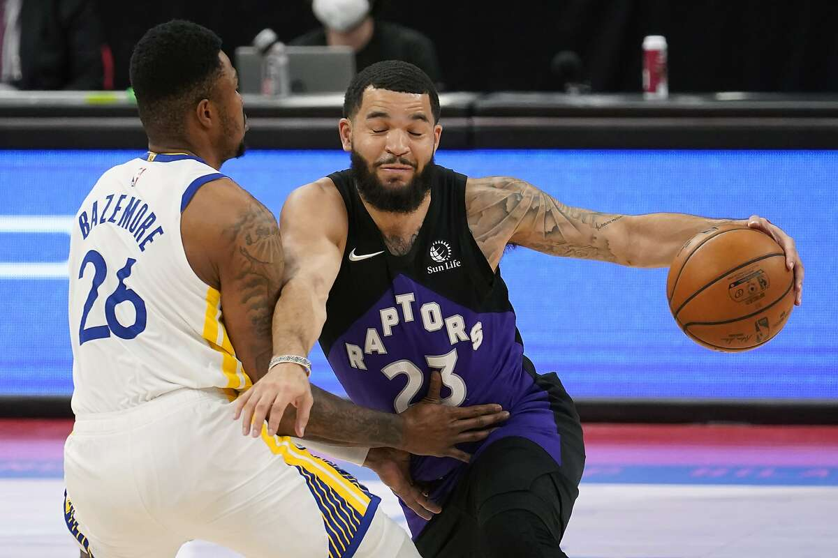 Toronto Raptors guard Fred VanVleet (23) crashes into Golden State Warriors forward Kent Bazemore (26) during the first half of an NBA basketball game Friday, April 2, 2021, in Tampa, Fla. (AP Photo/Chris O'Meara)
