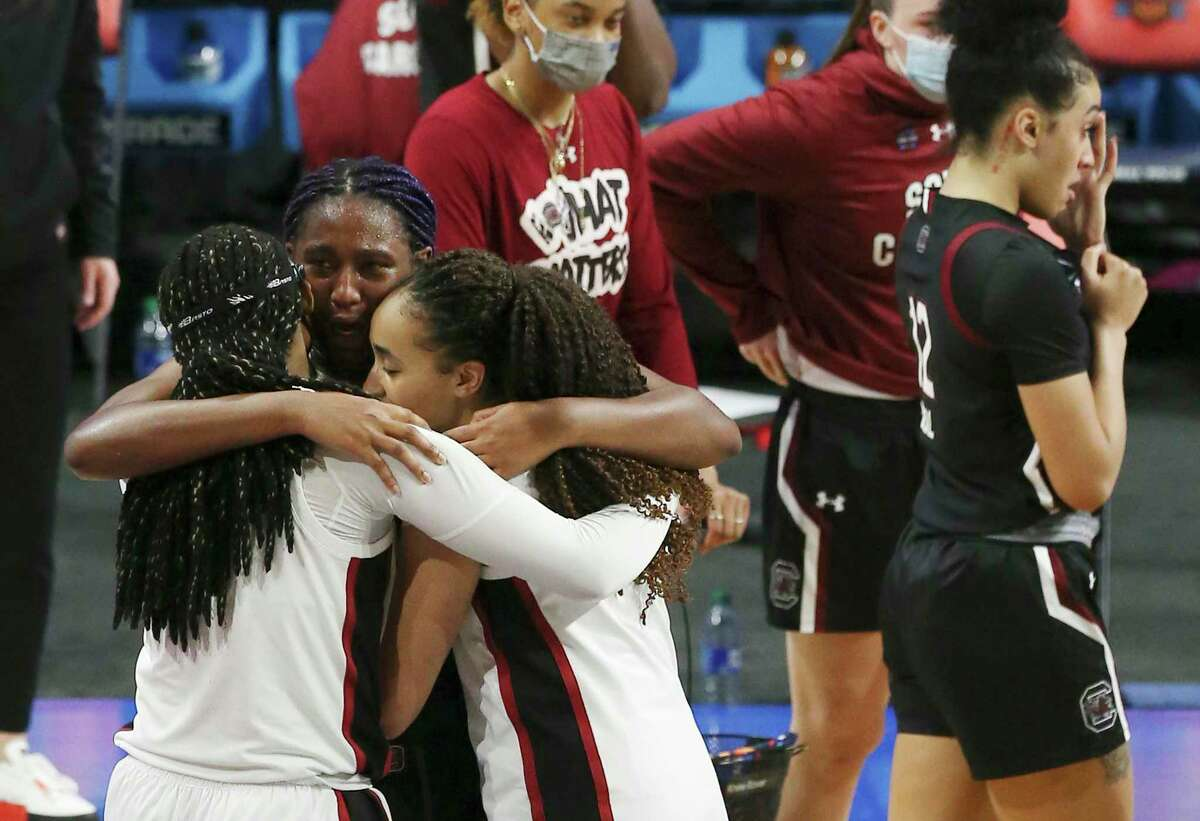 Stanford's Haley Jones (30) and Francesca Belibi (05) consoles South Carolina's Aliyah Boston (04) after their 2021 NCAA Women's Final Four national semifinal basketball game at the Alamodome on Friday, Apr. 2, 2021. Stanford defeated South Carolina, 66-65 to advance to the championship game.