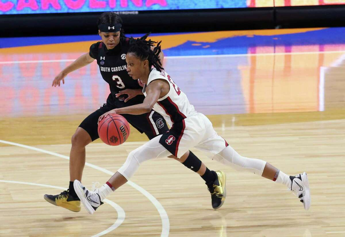 Stanford's Kiana Williams, in white, pushes the ball up the court against South Carolina's Destanni Hendersonduring their 2021 NCAA Women's Final Four national semifinal game at the Alamodome on Friday, Apr. 2, 2021.