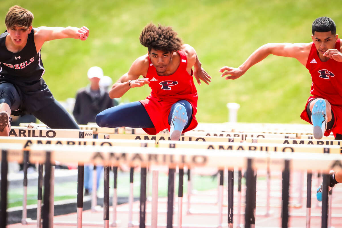 Plainview's Denzel Williams (center) won the boys 110-meter hurdles and teammate Aidan Herredia (right) finished second during the District 3-5A track and field meet on Friday.