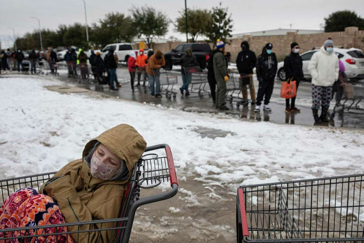 Camilla Swindle, 19, sits in a shopping cart as she and her boyfriend wait in a long line to enter a grocery store in Austin, Texas on Tuesday, Feb. 16, 2021, as people stock up ahead of another expected storm. Huge winter storms have plunged large parts of the central and southern United States into an energy crisis this week as frigid blasts of Arctic weather crippled electric grids and left millions of Americans without power amid dangerously cold temperatures. (Tamir Kalifa/The New York Times)