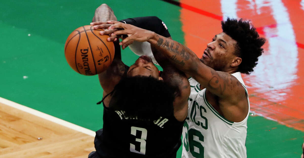 Boston Celtics' Marcus Smart blocks a shot by Houston Rockets' Kevin Porter Jr. during the second quarter of an NBA basketball game Friday, April 2, 2021, in Boston. (AP Photo/Winslow Townson)