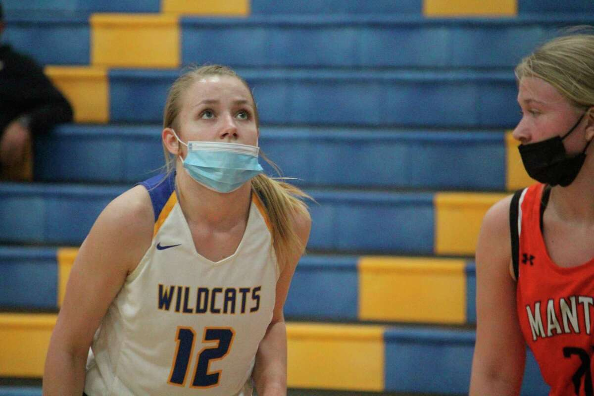 Evart's Kara Henry (12) has been talented in basketball, volleyball and track for the Wildcats. (Pioneer file photo)