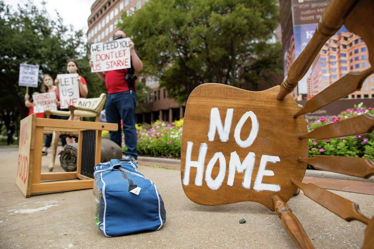 """Protesters place furniture and rally outside the Dallas office of Sen. John Cornyn, R-Texas, """"to show him the reality of the eviction crisis"""" in this Sept. 1 file photo. Although the Center for Disease Control renewed its order halting evictions until the end of June, the Texas Supreme Court let state guidelines expire March 31. (Juan Figueroa/The Dallas Morning News/TNS)"""